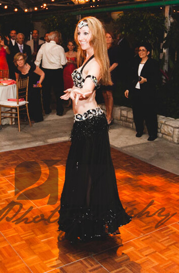 Donna performs a belly dancing routine for an event