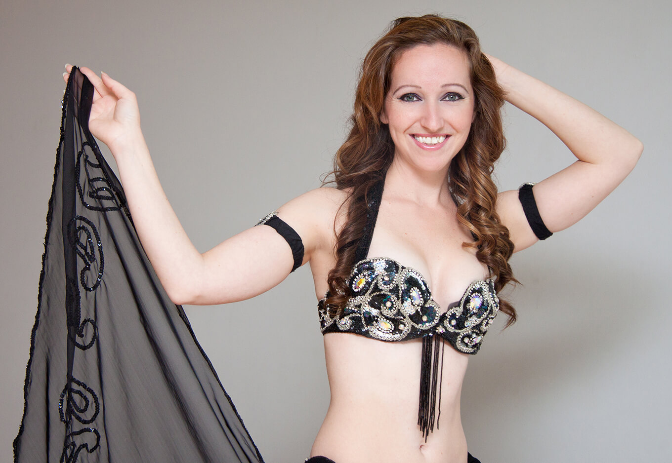 Donna showcasing one of her black belly dance outfits