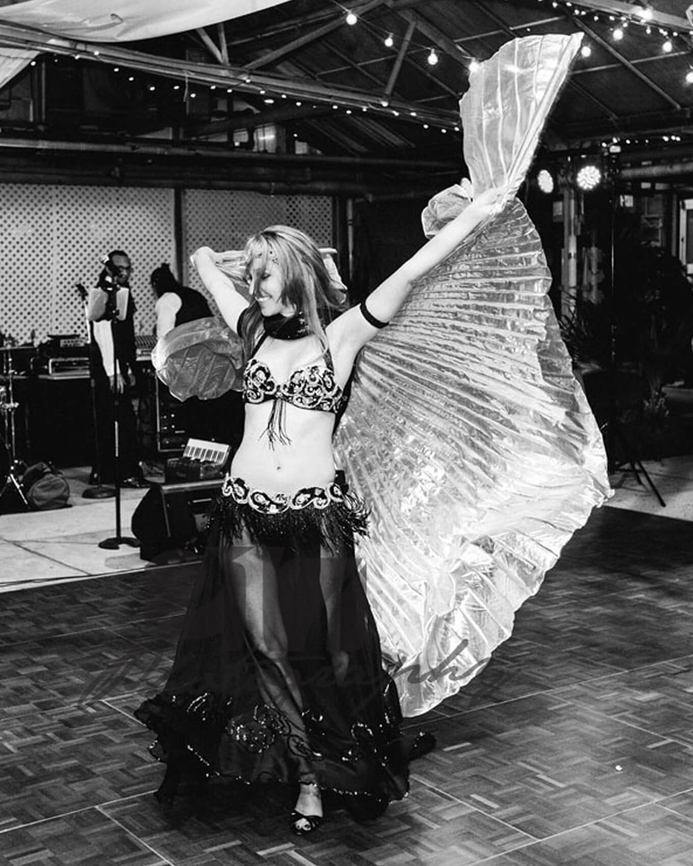 Donna using isis wings at an event