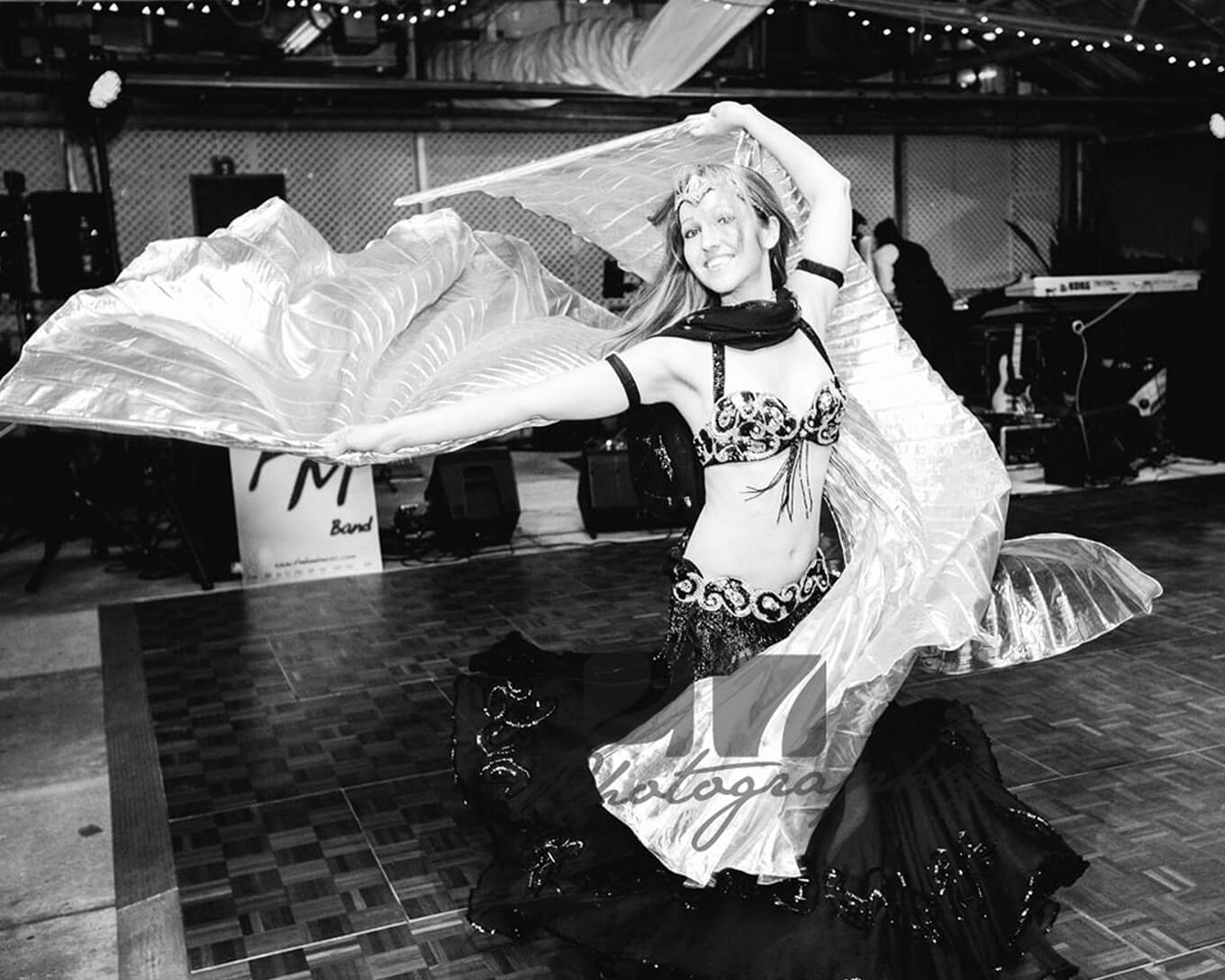 Donna wearing her isis wings belly dance outfit. Performing at a wedding event.