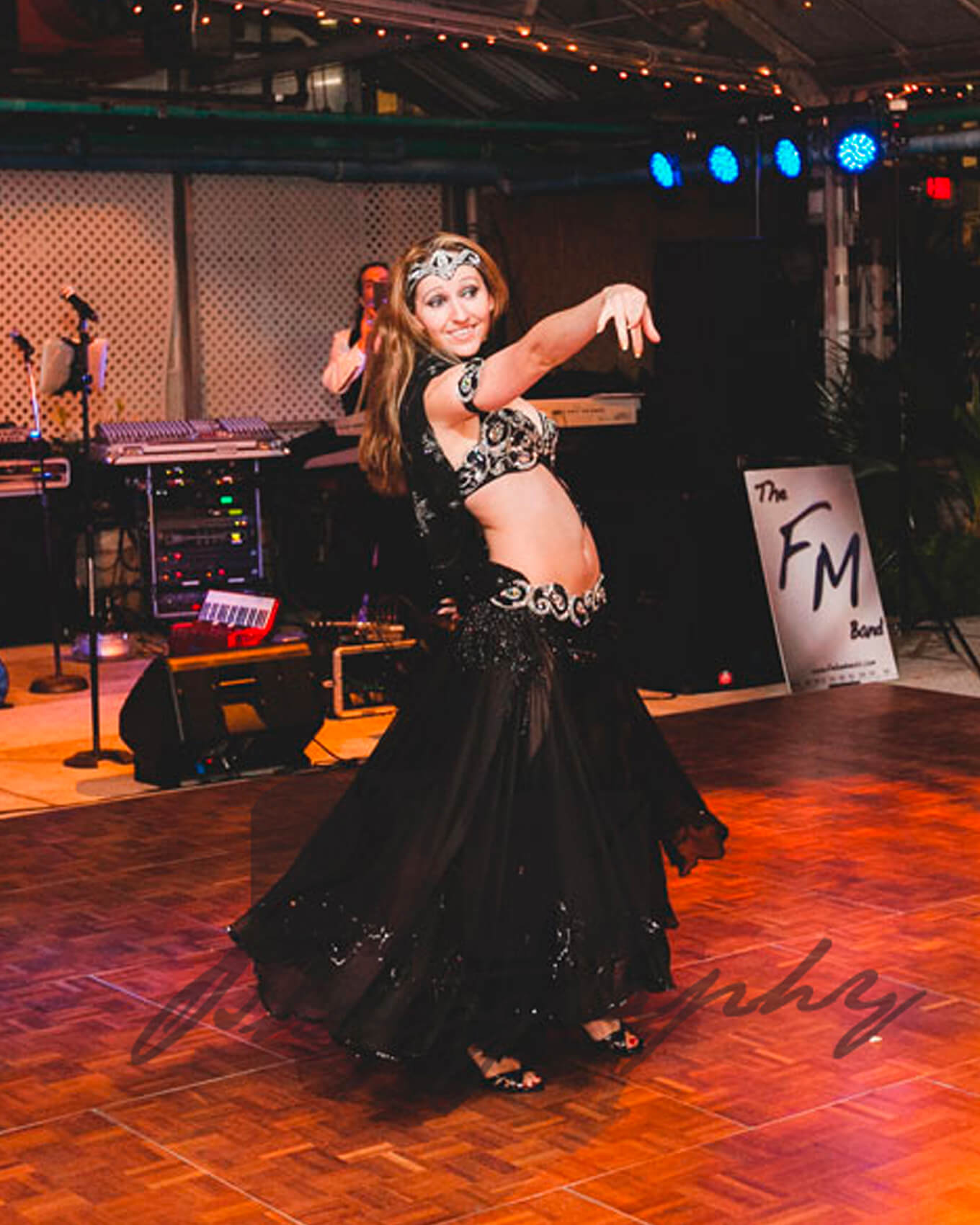 Donna performs a live belly dancing show at an event