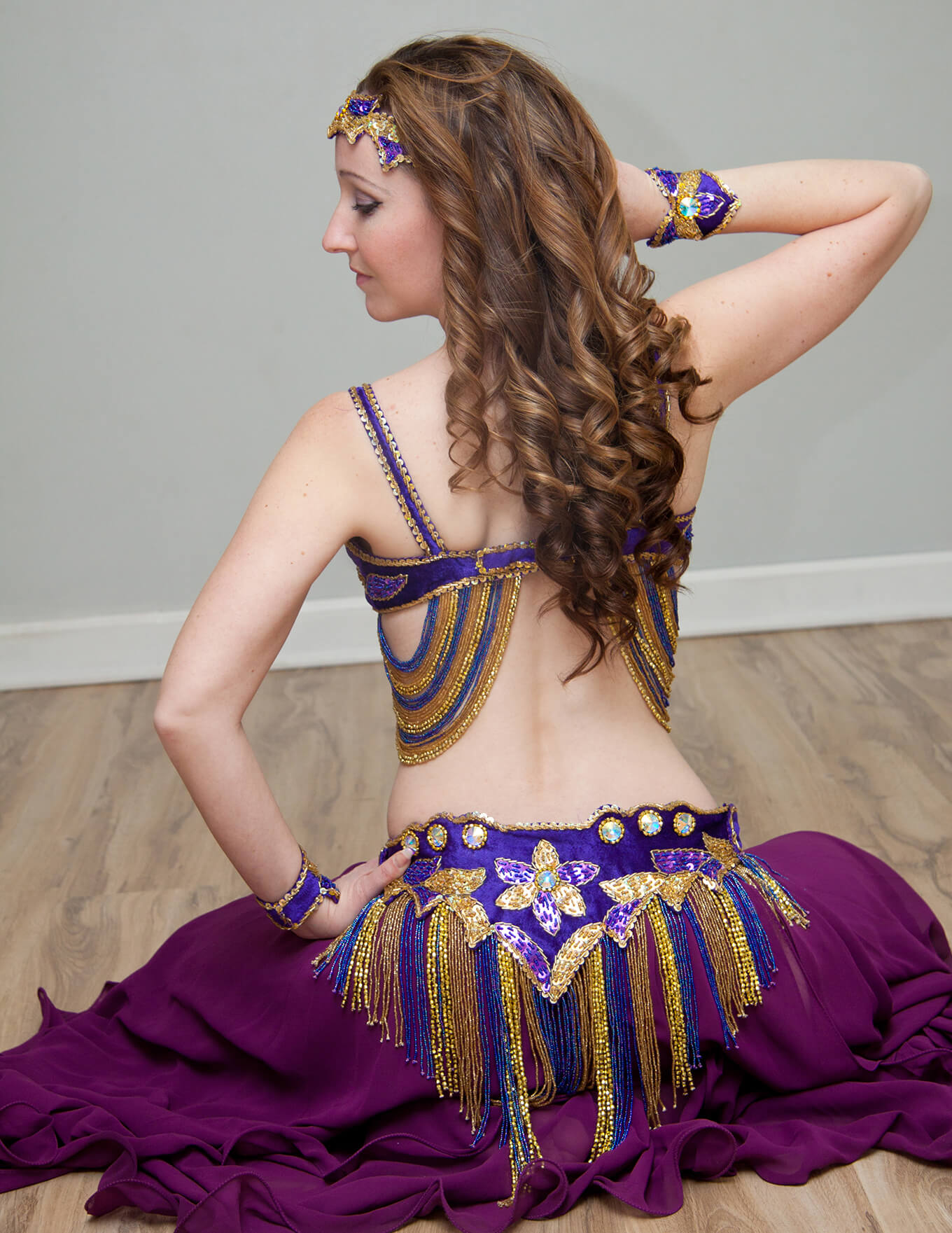 Donna in a purple belly dance outfit