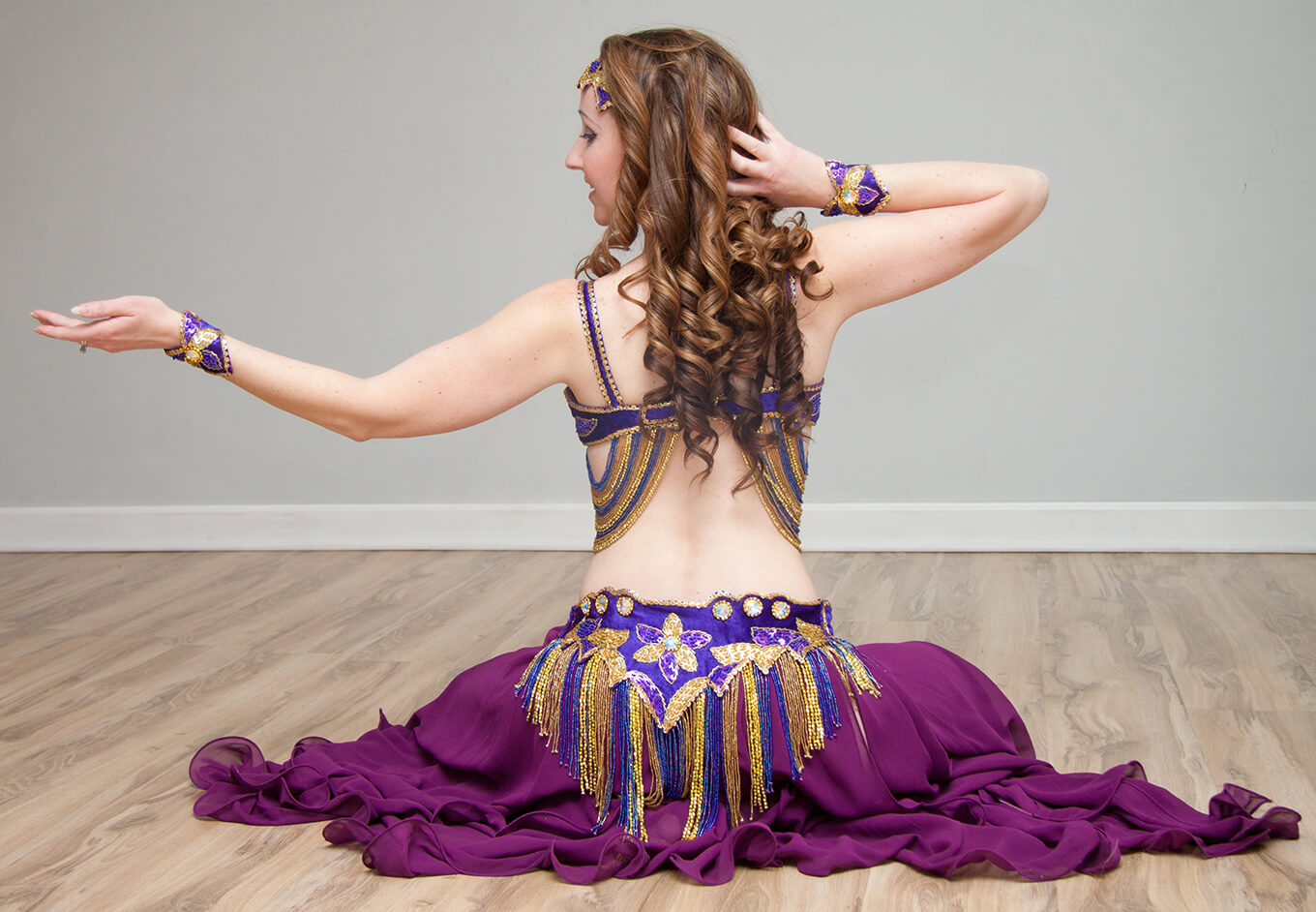 Donna showcasing one of her purple belly dance outfits