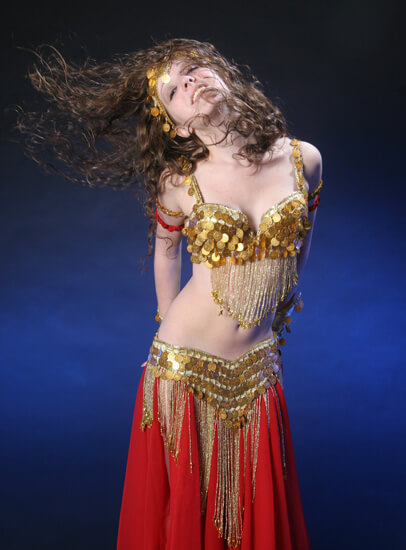 Donna in a red and gold belly dance outfit