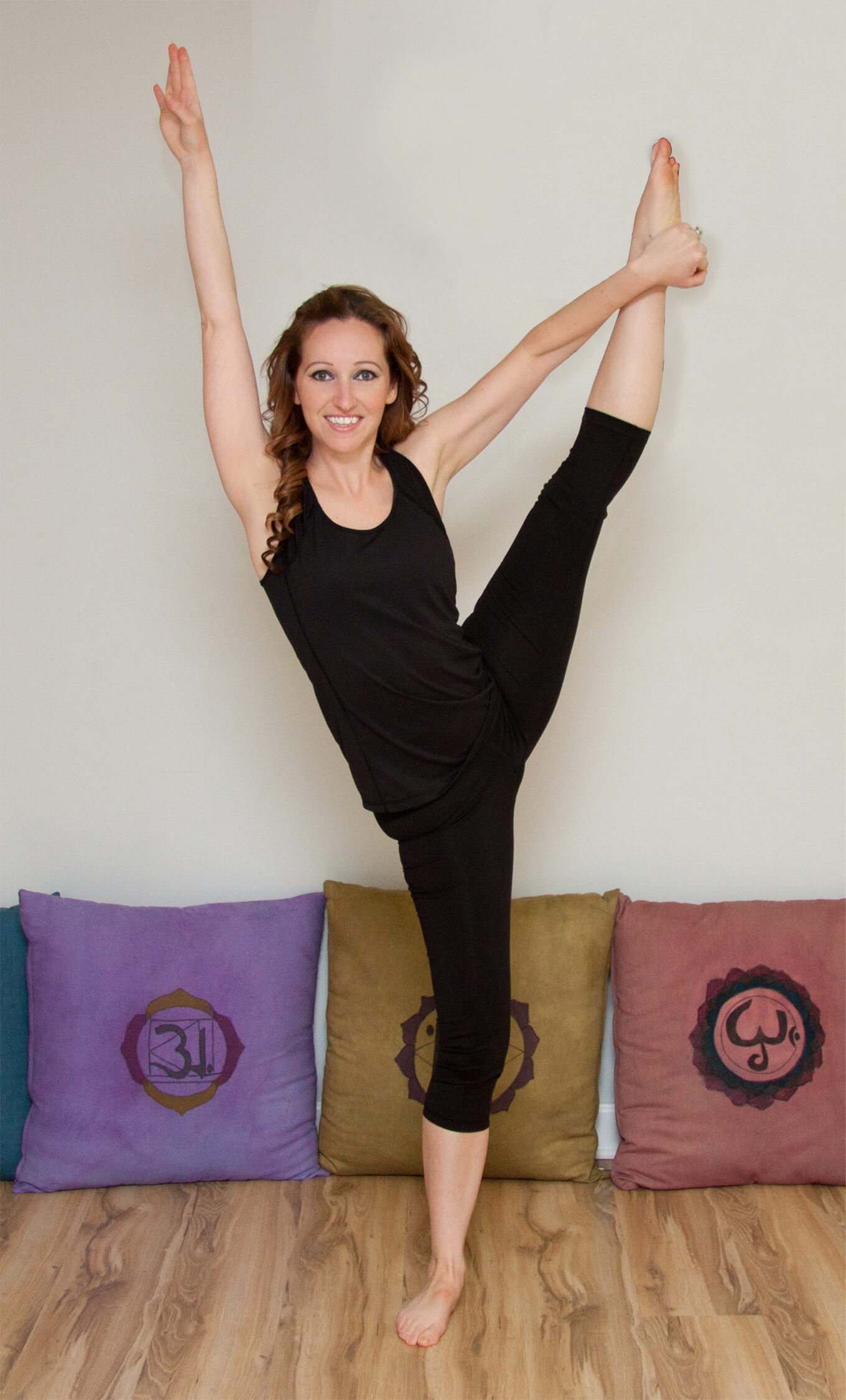 Donna showing how to balance a leg extension for yoga class.
